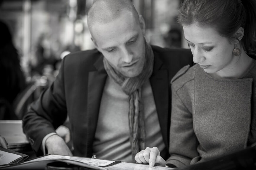 Couple Deciding Together What to Eat from Menu